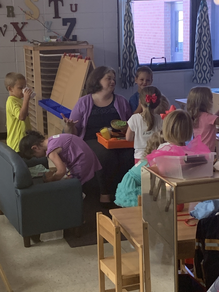 Mrs. Guilford surrounded by Preschoolers.